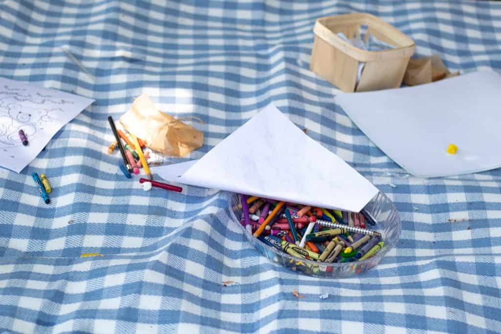 coloring supplies on picnic  blanket